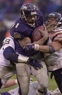 10 Dec 2000:  Jamal Lewis #31 of the Baltimore Ravens picks up yardage as he is stopped by Rodney Harrison #37 and Steve Tovar #59 of the San Diego Chargers as the Ravens clinched a playoff birth with a 24-3 defeat of the Chargers at PSINet Stadium in Bal