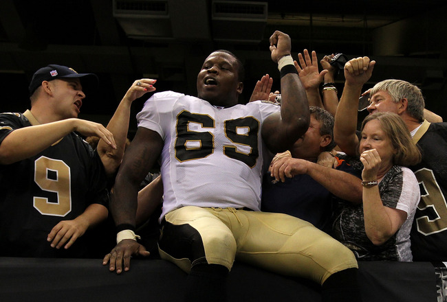 NEW ORLEANS - SEPTEMBER 09:  Anthony Hargrove #69 of the New Orleans Saints celebrates with fans in the stands after the Saints won 14-9 against the Minnesota Vikings at Louisiana Superdome on September 9, 2010 in New Orleans, Louisiana.  (Photo by Ronald