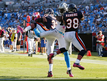 CHARLOTTE, NC - OCTOBER 10: Cornerback Charles Tillman #33 of the Chicago Bears intercepts a pass intended for wide receiver David Gettis #12 of the Carolina Panthers as safety Danieal Manning #38 of the Chicago Bears defends Bank of America Stadium on Oc