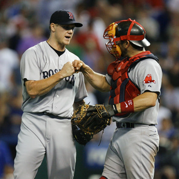KANSAS CITY, MO - AUGUST 18:  Jonathan Papelbon #58 of the Boston Red Sox and Jason Varitek #33 celebrate their 4-3 win over the Kansas City Royals at Kauffman Stadium on August 18, 2011 in Kansas City, Missouri. (Photo by Ed Zurga/Getty Images)