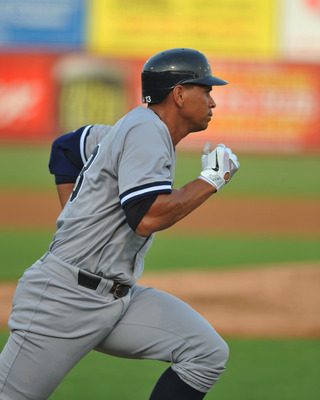 DUNEDIN, FL - AUGUST 12:  Designated hitter Alex Rodriguez #13 of the Tampa Yankees runs to first base against the Dunedin Blue Jays  August 12, 2011 at Florida Auto Exchange Stadium in Dunedin, Florida. Rodriguez played during a rehabilitation assignment
