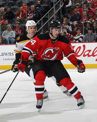 NEWARK, NJ - APRIL 10:  Adam Henrique #14 of the New Jersey Devils skates against the Boston Bruins at the Prudential Center on April 10, 2011 in Newark, New Jersey.  (Photo by Bruce Bennett/Getty Images)