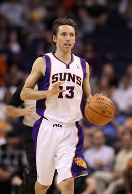 PHOENIX, AZ - MARCH 30:  Steve Nash #13 of the Phoenix Suns in action during the NBA game against the Oklahoma City Thunder at US Airways Center on March 30, 2011 in Phoenix, Arizona. The Thunder defeated the Suns 116-98.  NOTE TO USER: User expressly ack