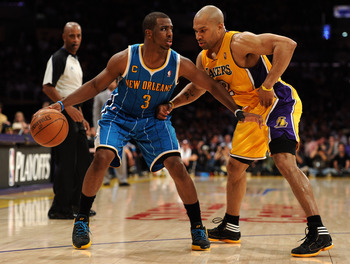 LOS ANGELES, CA - APRIL 26:  Chris Paul #3 of the New Orleans Hornets moves the ball against Derek Fisher #2 of the Los Angeles Lakers in Game Five of the Western Conference Quarterfinals in the 2011 NBA Playoffs on April 26, 2011 at Staples Center in Los