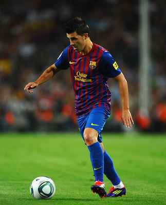 BARCELONA, SPAIN - AUGUST 17: David Villa of Barcelona in action during the Super Cup second leg match between Barcelona and Real Madrid at Nou Camp on August 17, 2011 in Barcelona, Spain.  (Photo by Laurence Griffiths/Getty Images)