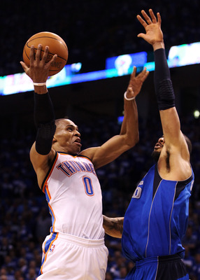 OKLAHOMA CITY, OK - MAY 21:  Russell Westbrook #0 of the Oklahoma City Thunder shoots the ball over Tyson Chandler #6 of the Dallas Mavericks in the fourth quarter in Game Three of the Western Conference Finals during the 2011 NBA Playoffs at Oklahoma Cit