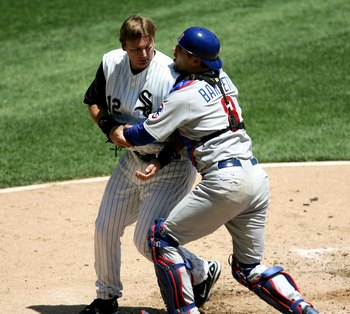 CHICAGO - MAY 20:  Michael Barrett #8 of the Chicago Cubs grabs A.J. Perizynski #12 of the Chicago White Sox after a 2nd inning collision at home plate on May 20, 2006 at U.S. Cellular Field in Chicago, Illinois.  (Photo by Jonathan Daniel/Getty Images)