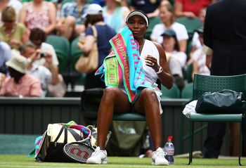 LONDON, ENGLAND - JUNE 27:  Venus Williams of the United States takes a break during her fourth round match against Tsvetana Pironkova of Bulgaria on Day Seven of the Wimbledon Lawn Tennis Championships at the All England Lawn Tennis and Croquet Club on J