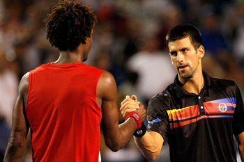 MASON, OH - AUGUST 19: Gael Monfils of France congratulates Novak Djokovic of Serbia after their match during the Western &amp; Southern Open at the Lindner Family Tennis Center on August 19, 2011 in Mason, Ohio.  (Photo by Matthew Stockman/Getty Images)
