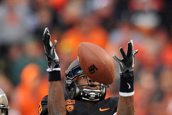 CORVALLIS, OR - DECEMBER 4: Markus Wheaton #2 of the Oregon State Beavers corrals a pass reception as Anthony Gildon #18 of the Oregon Ducks closes in during the fourth quarter of the game at Reser Stadium on December 4, 2010 in Corvallis, Oregon. The Duc