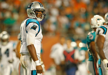 MIAMI GARDENS, FL - AUGUST 19:  Cam Newton #1 of the Carolina Panthers looks on during a Preseason NFL game against the Miami Dolphins at Sun Life Stadium on August 19, 2011 in Miami Gardens, Florida.  (Photo by Mike Ehrmann/Getty Images)