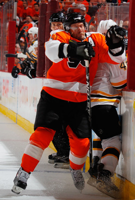 PHILADELPHIA, PA - MAY 02:  Rich Peverly #49 of the Boston Bruins is checked by Kimmo Timonen #44 of the Philadelphia Flyers during the second period of Game Two of the Eastern Conference Semifinals during the 2011 NHL Stanley Cup Playoffs at Wells Fargo