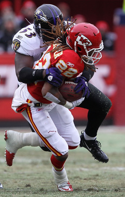 KANSAS CITY, MO - JANUARY 09:  Wide receiver Dexter McCluster #22 of the Kansas City Chiefs is tackled by linebacker Jameel McClain #53 of the Baltimore Ravens during their 2011 AFC wild card playoff game at Arrowhead Stadium on January 9, 2011 in Kansas