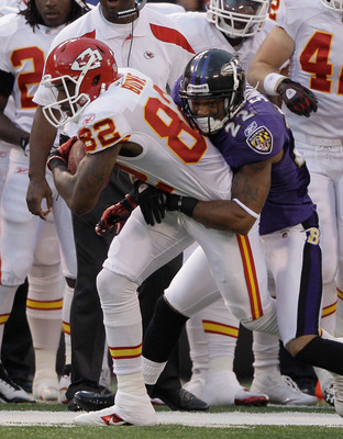 BALTIMORE, MD - AUGUST 19: Wide receiver Dwayne Bowe #82 of the Kansas City Chiefs is tackled by Jimmy Smith #22 of the Baltimore Ravens after a pass reception during the first half of a preseason game at M&T Bank Stadium on August 19, 2011 in Baltimore,