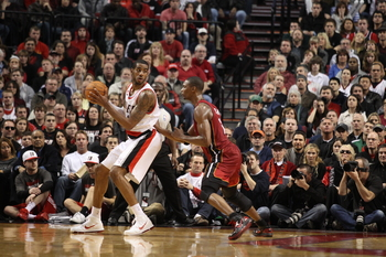PORTLAND, OR - JANUARY 09: LaMarcus Aldridge #12 of the Portland Trail Blazers posts up against Chris Bosh #1 of the Miami Heat during a game on January 9, 2011 at the Rose Garden Arena in Portland, Oregon. NOTE TO USER: User expressly acknowledges and ag