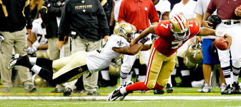 NEW ORLEANS, LA - AUGUST 12: Colin Kaepernick # 7 of the San Francisco 49ers is pushed out of bounds by Jabari Greer # 32 New Orleans Saints during their pre season game at Louisiana Superdome on August 12, 2011 in New Orleans, Louisiana.  (Photo by Sean