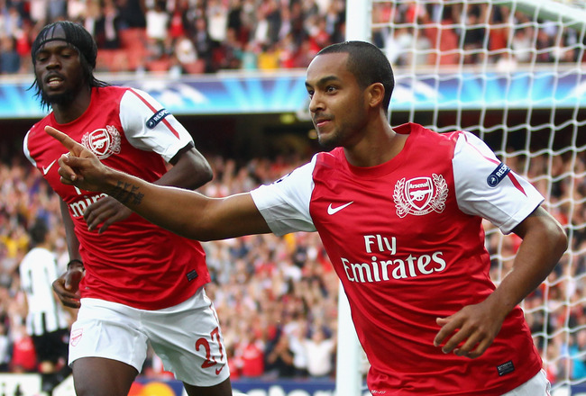 LONDON, ENGLAND - AUGUST 16:  Theo Walcott of Arsenal celebrates scoring the opening goal during the UEFA Champions League play-off first leg match between Arsenal and Udinese at the Emirates Stadium on August 16, 2011 in London, England.  (Photo by Julia