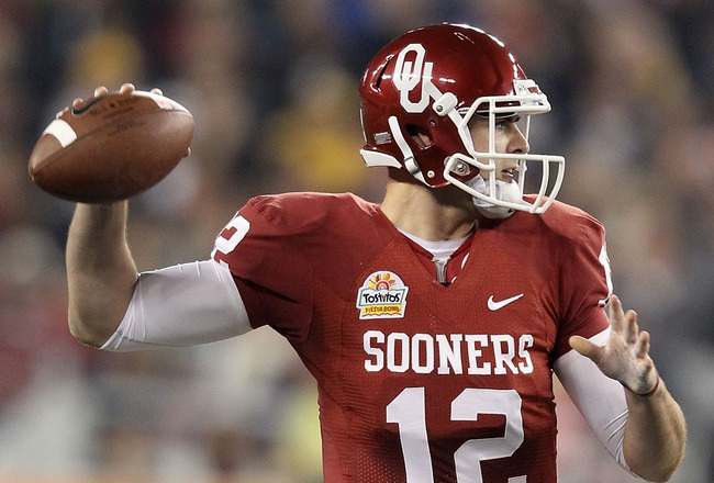 GLENDALE, AZ - JANUARY 01:  Landry Jones #12 of the Oklahoma Sooners throws the ball in the second half against the Connecticut Huskies during the Tostitos Fiesta Bowl at the Universtity of Phoenix Stadium on January 1, 2011 in Glendale, Arizona.  (Photo 