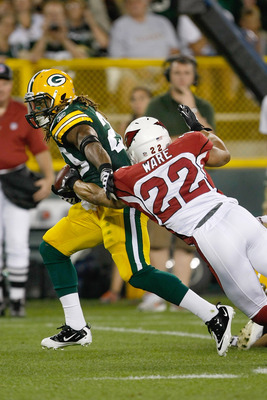 GREEN BAY, WI - AUGUST 19: Alex Green #20 of the Green Bay Packers runs as he is pursued by Matt Ware #22 of the Arizona Cardinals in a preseason game at Lambeau Field on August 19, 2011 in Green Bay, Wisconsin. (Photo by Scott Boehm/Getty Images)