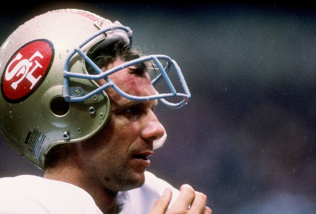 31 Jul 1988: Quarterback Joe Montana of the San Francisco 49ers stands on the sidelines during the American Bowl against the Miami Dolphins at Wembley Stadium in London, England. The Dolphins won the game 27-21.