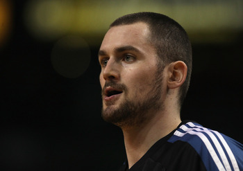 BOSTON, MA - JANUARY 03:  Kevin Love #42 of the Minnesota Timberwolves looks on before the game against the Boston Celtics on January 3, 2011 at the TD Garden in Boston, Massachusetts. NOTE TO USER: User expressly acknowledges and agrees that, by download