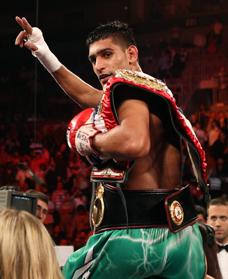 LAS VEGAS, NV - JULY 23:  Amir Khan celebrates after his fifth round knockout of Zab Judah in their super lightweight world championship unification bout at Mandalay Bay Events Center on July 23, 2011 in Las Vegas, Nevada.  (Photo by Scott Heavey/Getty Im