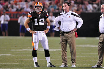 CLEVELAND, OH - AUGUST 19: Starting quarterback Colt McCoy #12 and head coach Pat Shurmur of the Cleveland Browns wait for a challenge ruling from the officials during the second quarter against the Detroit Lionsat Cleveland Browns Stadium on August 19, 2