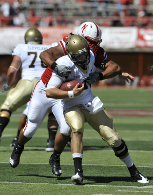 LINCOLN, NE - SEPTEMBER 11: Nebraska Cornhuskers defensive tackle Terrence Moore #90 takes down Idaho Vandals quarterback Brian Reader #14 during second half action of their game at Memorial Stadium on September 4, 2010 in Lincoln, Nebraska. Nebraska Defe