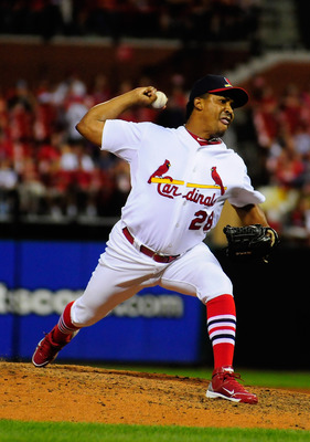 ST. LOUIS, MO - AUGUST 14: Octavio Dotel #28 of the St. Louis Cardinals throws to a Colorado Rockies batter at Busch Stadium on August 14, 2011 in St. Louis, Missouri.  (Photo by Jeff Curry/Getty Images)
