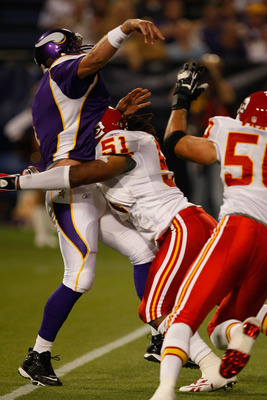 MINNEAPOLIS, MN - AUGUST 21: Quarterback Brett Favre #4 of the Minnesota Vikings gets tackled just after passing the football by linebacker Corey Mays #51 the Kansas City Chiefs at Hubert H. Humphrey Metrodome on August 21, 2009 in Minneapolis, Minnesota.