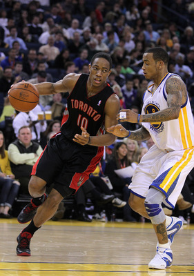 OAKLAND, CA - MARCH 25: DeMar DeRozan #10 of the Toronto Raptors drives on Monta Ellis #8 of the Golden State Warriors at Oracle Arena on March 25, 2011 in Oakland, California. NOTE TO USER: User expressly acknowledges and agrees that, by downloading and