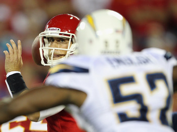 KANSAS CITY, MO - SEPTEMBER 13:  Quarterback Matt Cassel #7 of the Kansas City Chiefs passes as he is rushed by Larry English #52 of the San Diego Chargers during the 1st quarter of the game against on September 13, 2010 at Arrowhead Stadium in Kansas Cit