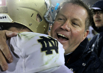 LOS ANGELES, CA - NOVEMBER 27:  Head coach Brian Kelly and quarterback Tommy Rees #13 of the Notre Dame Fighting Irish embrace after the game against the USC Trojans at the Los Angeles Memorial Coliseum on November 27, 2010 in Los Angeles, California.  No