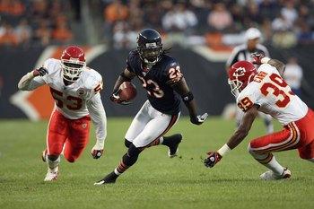 CHICAGO - AUGUST 7:  Devin Hester #23 of the Chicago Bears carries the ball against Demorrio Williams #53 and Brandon Carr #39 of the Kansas City Chiefs during a preseason game on August 7, 2008 at Soldier Field in Chicago, Illinois. (Photo by Jonathan Da