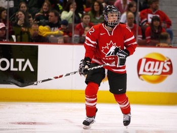 OTTAWA, ON - JANUARY 01:  Meaghan Mikkelson #12 of Team Canada skates during the game against Team USA at Scotiabank Place on January 1, 2010 in Ottawa, Canada.  (Photo by Phillip MacCallum/Getty Images)