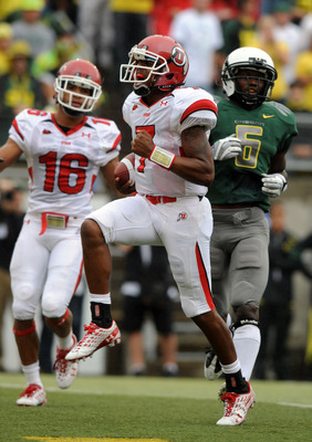 EUGENE, OR - SEPTEMBER 19: Quarterback Terrance Cain #7 of the Utah Utes celebrates his touchdown run in the first quarter of the game against the Oregon Ducks at Autzen Stadium on September 19, 2009 in Eugene, Oregon. (Photo by Steve Dykes/Getty Images)