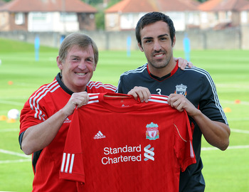 LIVERPOOL, ENGLAND - AUGUST 18:  (THE SUN OUT) In this handout photo provided by Liverpool FC, Manager Kenny Dalglish of Liverpool (L) with new signing Jose Enrique during a press conference at the club's Melwood training ground on August 18, 2011 in Live
