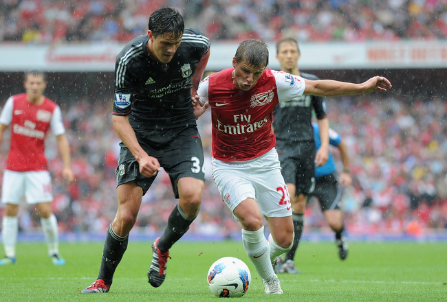 LONDON, ENGLAND - AUGUST 20:  Martin Kelly of Liverpool and Andrey Arshavin of Arsenal battle for the ball during the Barclays Premier League match between Arsenal and Liverpool at the Emirates Stadium on August 20, 2011 in London, England.  (Photo by Mic