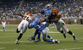 DETROIT - AUGUST 12: Jahvid Best #44 of the Detroit Lions runs for a short gain as Ray Maualuga #58 of the Cincinnati Bengals makes the stop during the first quarter of the game at Ford Field on August 12, 2011 in Detroit, Michigan.  (Photo by Leon Halip/