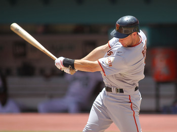 A rarely-seen view of Brandon Belt swinging a bat in a game