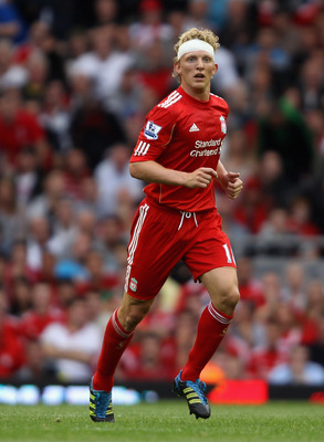 LIVERPOOL, ENGLAND - AUGUST 13:  Dirk Kuyt of Liverpool with a head bandage during the Barclays Premier League match between Liverpool and Sunderland at Anfield on August 13, 2011 in Liverpool, England.  (Photo by Clive Brunskill/Getty Images)