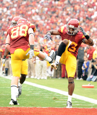 LOS ANGELES, CA - OCTOBER 16:  Ronald Johnson #83 of the USC Trojans celebrates his touchdown with Blake Ayles #88 for a 35-0 lead over the California Golden Bears during the second quarter at Los Angeles Memorial Coliseum on October 16, 2010 in Los Angel