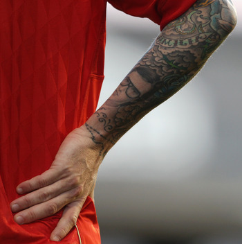 LONDON, ENGLAND - MAY 09:  A detailed view of Raul Meireles of Liverpoo's tattoosl during the Barclays Premier League match between Fulham and Liverpool at Craven Cottage on May 9, 2011 in London, England.  (Photo by Scott Heavey/Getty Images)