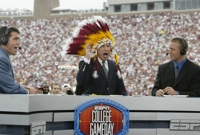 TALLAHASSEE, FL - OCTOBER 26:  ESPN College GameDay announcer Lee Corso dons an FSU headress as co-announcers (l to r) Chris Fowler and Kirk Herbstreit comment during the NCAA football game between Notre Dame and Florida State at Doak Campbell Stadium on