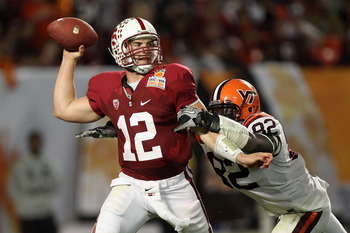 MIAMI, FL - JANUARY 03: Andrew Luck #12 of the Stanford Cardinal throws a pass against Steven Friday #82 of the Virginia Tech Hokies during the 2011 Discover Orange Bowl at Sun Life Stadium on January 3, 2011 in Miami, Florida. (Photo by Streeter Lecka/Ge