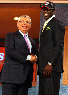 NEW YORK - JUNE 25:  NBA Commissioner David Stern poses for a photograph with the seventeenth overall draft pick by the Philadelphia 76ers,  Jrue Holiday during the 2009 NBA Draft at the Wamu Theatre at Madison Square Garden June 25, 2009 in New York City