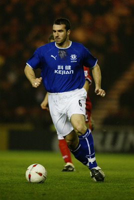 MIDDLESBROUGH - DECEMBER 3:  David Unsworth of Everton running with the ball during the Carling Cup fourth round match between Middlesbrough and Everton on December 3, 2003 at The Riverside Stadium in Middlesbrough, England.  Middlesbrough won 5-4 on pena