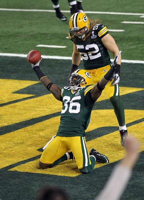 ARLINGTON, TX - FEBRUARY 06:  Nick Collins #36 of the Green Bay Packers celebrates with teammate Clay Matthews #52 after Collins returned an interception for a touchdown against the Pittsburgh Steelers during Super Bowl XLV at Cowboys Stadium on February