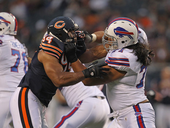 CHICAGO, IL - AUGUST 13: Vernon Gholston #94 of the Chicago Bears rushes against Ed Wang #71 of the Buffalo Bills during a preseason game at Soldier Field on August 13, 2011 in Chicago, Illinois.The Bears defeated the Bills 10-3. (Photo by Jonathan Daniel