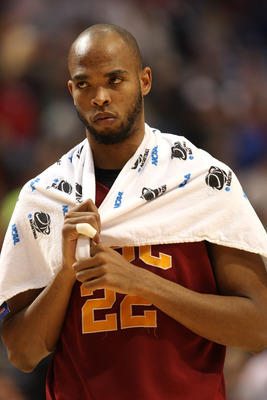 MINNEAPOLIS - MARCH 22:  Taj Gibson #22 of the USC Trojans walks off the court dejected after USC lost 74-69 against the Michigan State Spartans during the second round of the NCAA Division I Men's Basketball Tournament at the Hubert H. Humphrey Metrodome